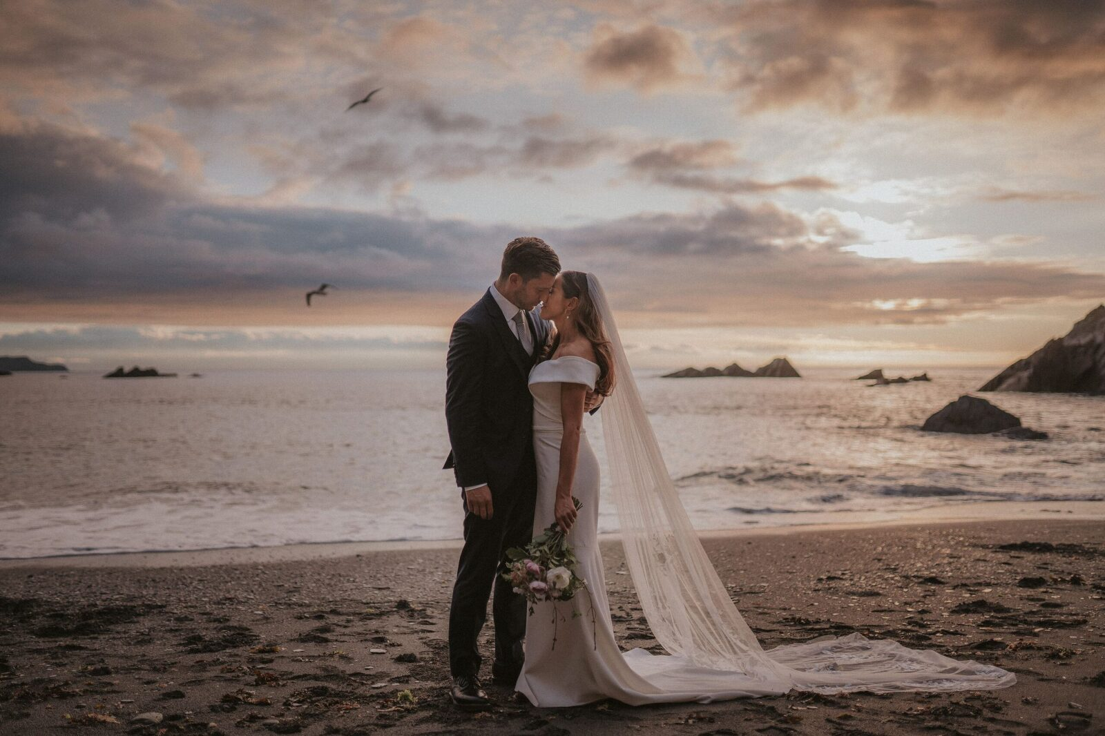 Bride and groom portrait at tunnels beaches